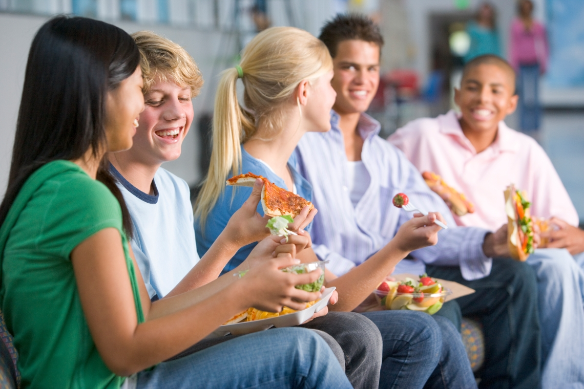Teenagers enjoying lunch together