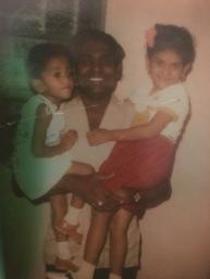 Mr. Kanagasabapathy holding Manivillie (aged 3) and Manimolie (aged 5)
