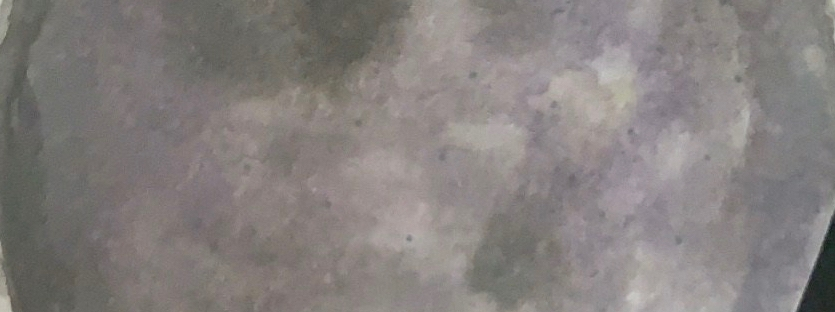 Full moon painting on white bullet journal paper, in tones of grey and purple.
